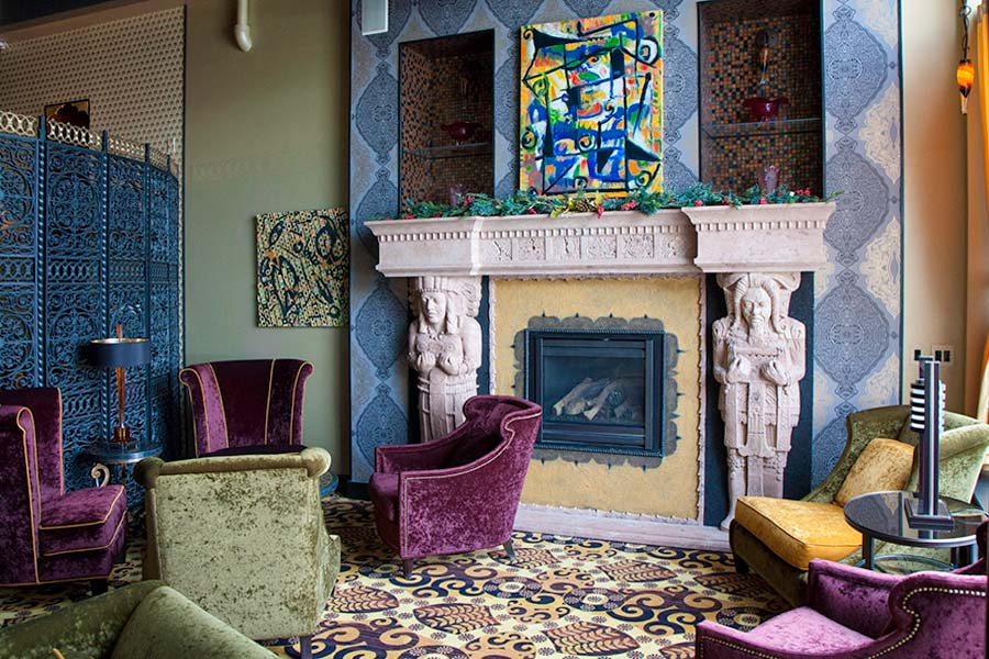 Lounge area and fireplace of The Giacomo Hotel