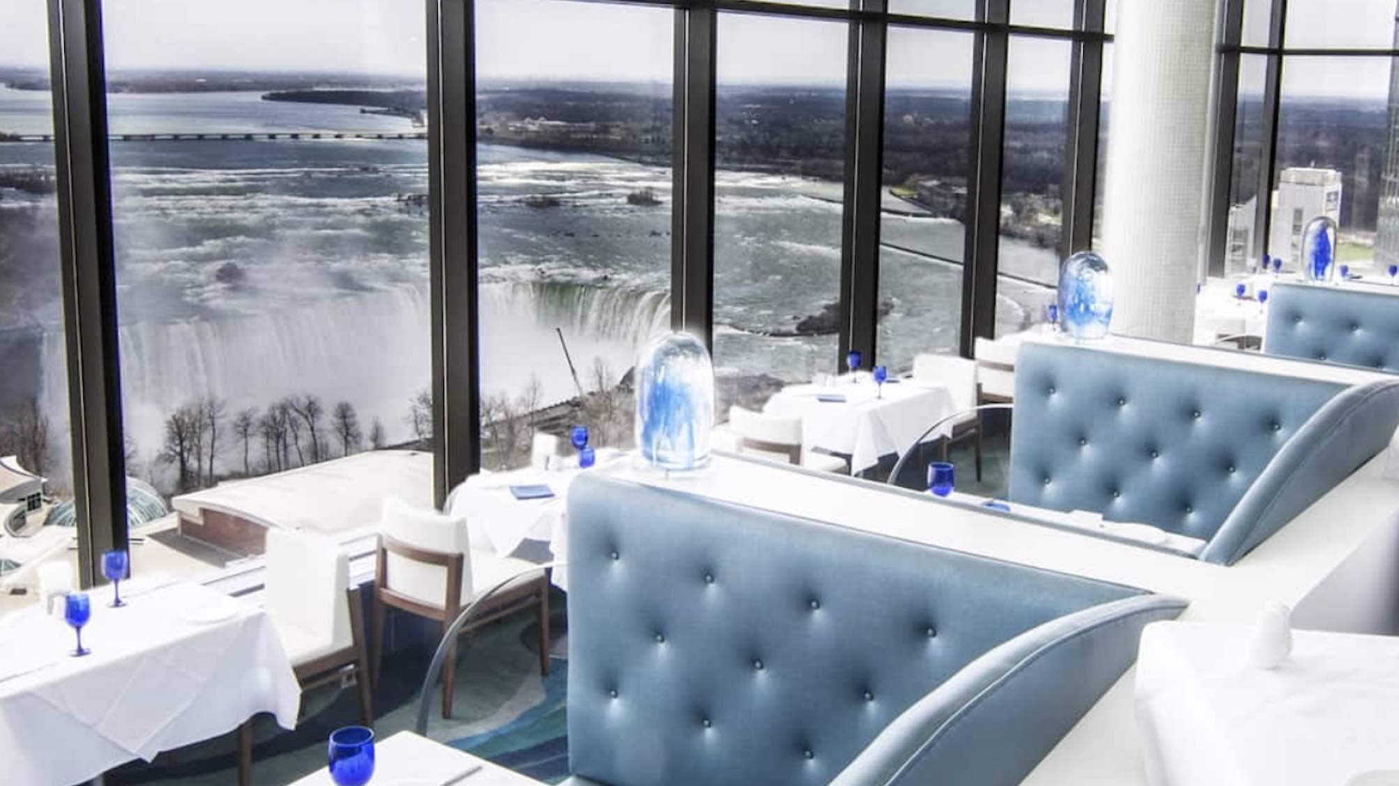 Hilton Niagara Falls:Fallsview Hotel & Suites luxury hotels in niagara falls restaurant seating with falls view